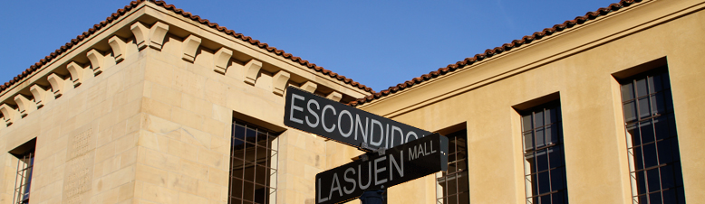 Photo of Cubberley Education Building and a street sign of Escondido and Lasuen Mall intersection