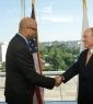 Jim Shelton MA/MBA '93, deputy secretary of education, swears in Ted Mitchell PhD '83 as under secretary of education.